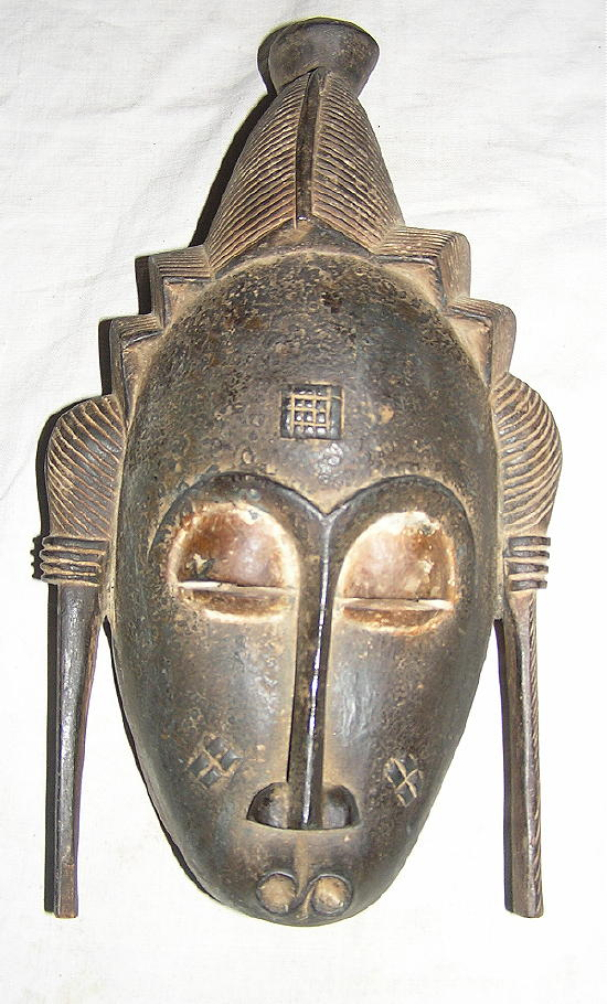 http://www.art-africain.com/masque_africain/masque_cotedivoire/masque_africain_baoule_cote_d_ivoire_xo.jpg