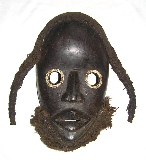 masque africain en metal